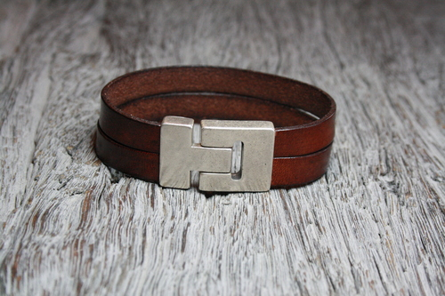 Brown bracelet with stitching