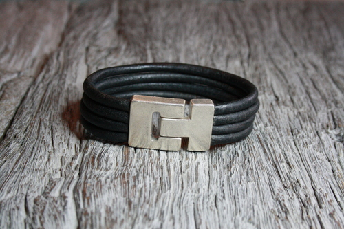 Black bracelet with stitching